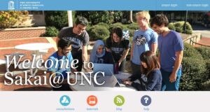 Sakai welcome header of diverse group of happy Carolina students looking at laptop outside with Sakaiger mascot on student's shoulder