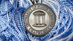 UNC seal on top of graduation tassels